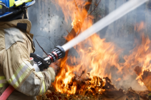 fire fighter spraying fire symbolic for disaster recovery