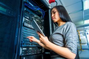 women working on data center using tablet