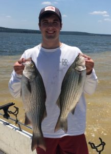 Scott Courtney holding two fish